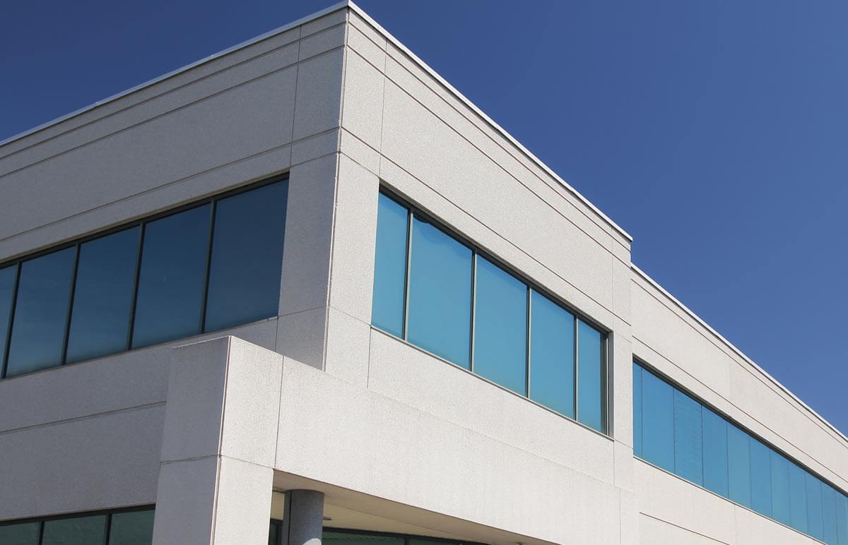 Exterior of an office building on a sunny day